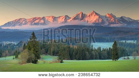 Panoramic View Of Tatra Mounains.tatra Mountains In The Morning. Beautiful Green Valley At Snowy Mou