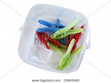 Plastic Container With Washing Powder And Multicolored Clothespins