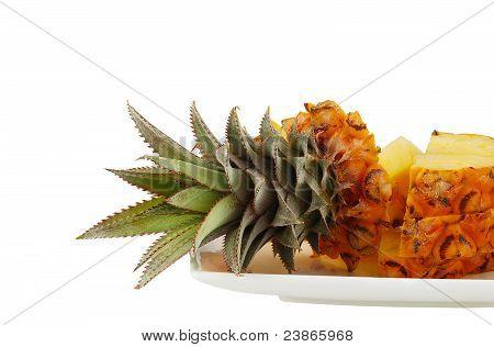 Sliced Pineapple On White Plate