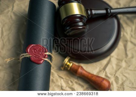 Last Will And Testament On Yellowish Paper With Wooden Judge Gavel Document