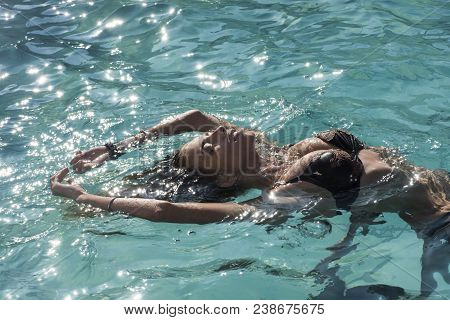 Relax In Spa Swimming Pool, Refreshment And Skincare. Summer Vacation And Travel To Ocean. Sexy Woma
