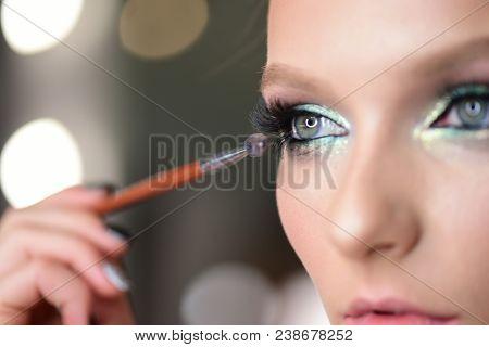 Woman Applying Black Mascara On Eyelashes With Makeup Brush. Young Beautiful Woman Applying Mascara