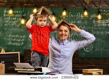 Smiling Adult Students During Break In Classroom Interior, Teacher Drawing At Classroom In School, A