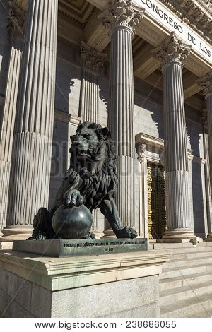 Madrid, Spain - January 22, 2018: Lion Sculpture In Front Of Building Of Congress Of Deputies (congr