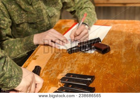 The Military Signs For Weapons, Gives Out Weapons Against The Signature