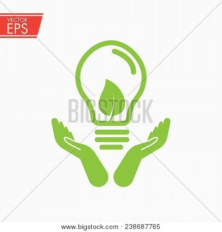Green Ecology Bulb On Hand. Light Bulb In Hand. Ecology Bulp Lamp With Leaf Logo. Energy Saving Lamp