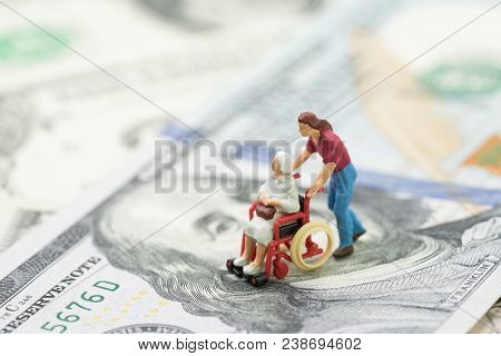 Cost Of Retirement Living, Health Insurance Or Medical Industry Business Concept, Miniature Senior O