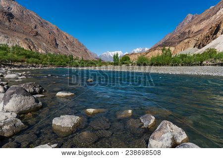 Landscape Of River, Mountains And Forest In Summer At Northern Countryside Area In Pakistan