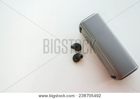 Isolated Close Up Wireless Portable Speaker With Earphones For Connection To Listen Music