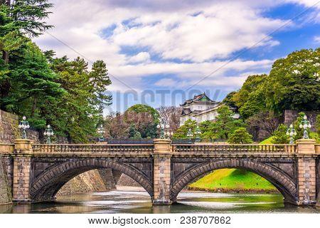 Tokyo, Japan at the Imperial Palace moat and bridge.