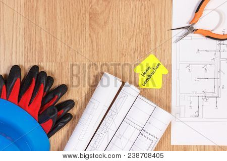 Protective Blue Helmet With Gloves, Metal Pliers, Diagrams Or Electrical Construction Drawings And Y