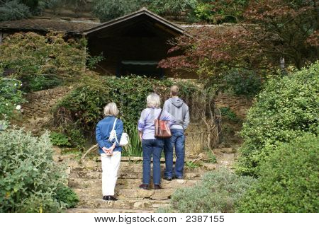 Visitors/ Tourists Standing Looking At Something