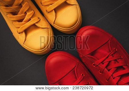 Young Adult People On A Love Date, Conceptual Image. Top View Of Two Pair Of Casual Sneakers, Yellow