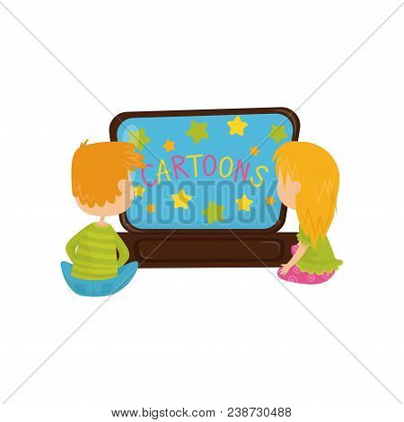 Little Children Watching Cartoon. Two Kids, Boy And Girl Sitting On Floor In Front Of Tv. Brother An