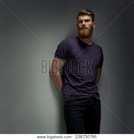 Young Bearded Man, Model Of Fashion, Looks Into The Distance Wearing Casual Clothes. Guy With Beard
