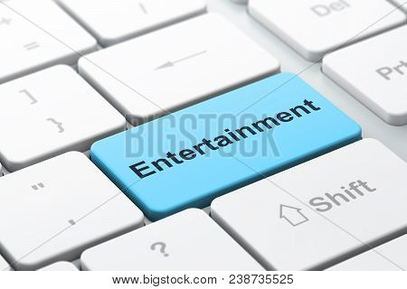 Entertainment, Concept: Computer Keyboard With Word Entertainment, Selected Focus On Enter Button Ba
