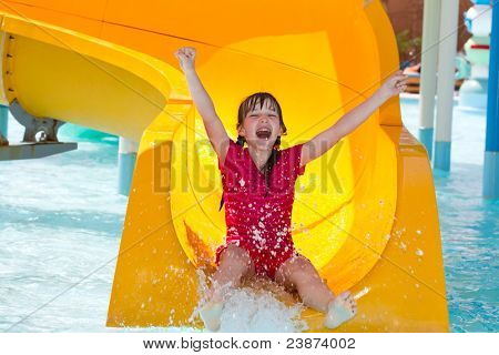Happy girl on waterslide
