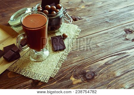 Delicious Chocolate Smoothie With Marshmallows On Dark Table.