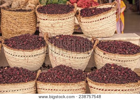 Hibiscus Dry Herb In Sale. Hibiscus Lilac Flowers In Baskets. Natural Organic Herbs. Condiment And I