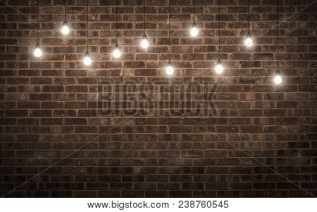 Shining Light Bulbs On Dark Brick Wall. 3d Rendering