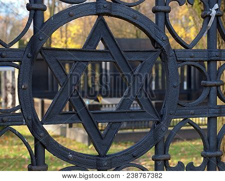 A Star From The Gate Of The Kirkut. Lodz, Poland - November 05, 2017 Jewish Star Of David At The Ent