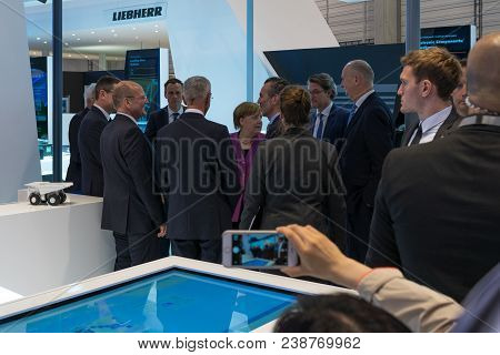 Berlin, Germany - April 25, 2018: Visit Of Chancellor Of Germany Angela Merkel To The Stand Of Liebh