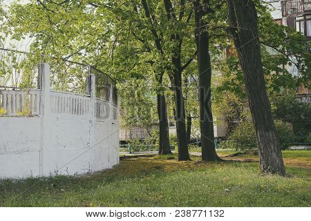The Fence Is White. Old Fence. Photo Of A Beautiful Fence. Beautiful Vintage Photo Of A White Fence