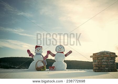 Snowman Couple With Present Box. Christmas Or Xmas Tree Decoration Toy In Basket. New Year Snowmen F