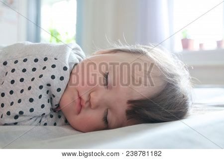 Baby Sleeping Portrait Close Up, Daytime Resting On Bed In Sun Rays, Health Care. Little Girl Sleep