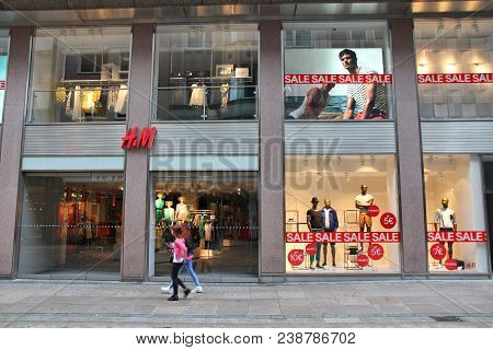 Dortmund, Germany - July 15, 2012: People Walk By H&m (h And M) Fashion Store In Dortmund, Germany.