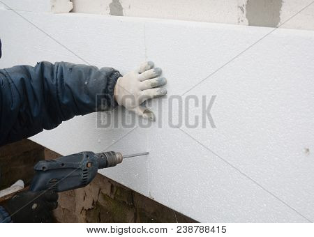 Building Contractor Insulating House Wall With Styrofoam Insulation Sheets