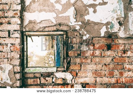 Old Dirty Brick Wall Of Red Brick With A Clogged Window