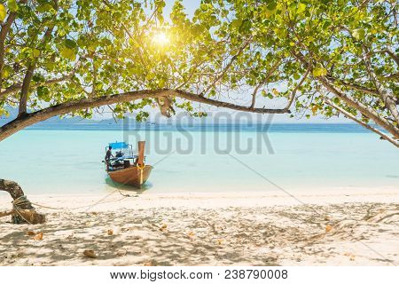 Longtail Boat In Thailand With Turquoise Blue Sea In Asia