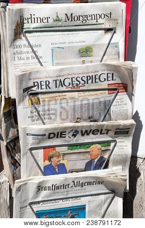 Berlin - Apr 28, 2018: Newspaper Stand With Various German Newspapers And Angela Merkel And Donald T