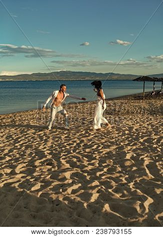 Sensual Couple. Man And Woman Dancing, Couple Happy On Vacation. Couple In Love Running On Beach, Se
