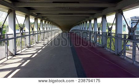 Covered Pedestrian And Bicycle Footbridge, Without People.