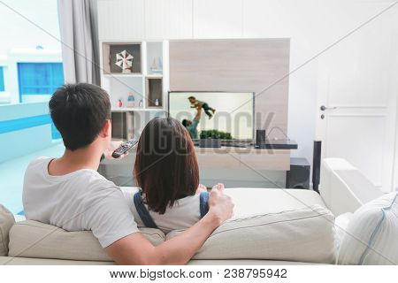 Happy Family Watches Television At Home On Weekend.