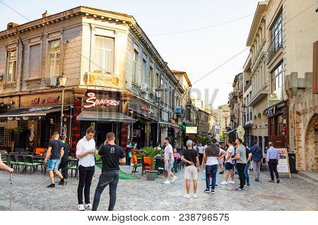 Bucharest, Rumania - 28.04.2018: Tourists In Old Town And Restaurants On Downtown Lipscani Street, O