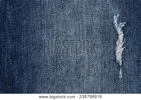 Denim Jeans Texture Or Denim Jeans Background With Old Torn. Old Grunge Vintage Denim Jeans.