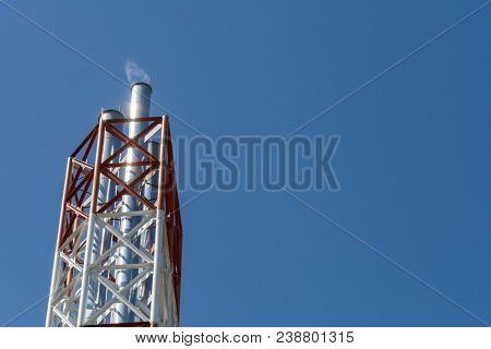Pipes Of A Thermal Station Against A Blue Sky