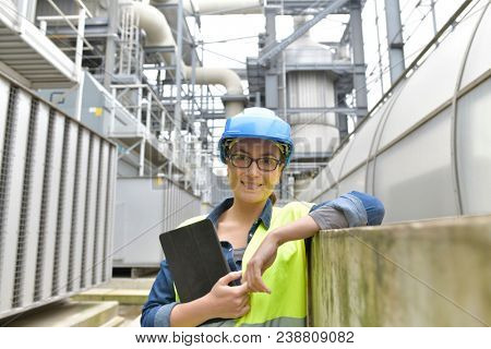 Industrial engineer standing in recycling plant