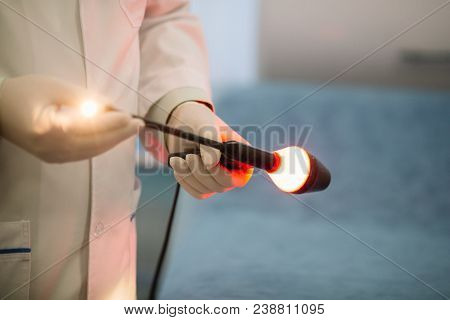 Proctologist Holding An Anoscope. In The Hospital