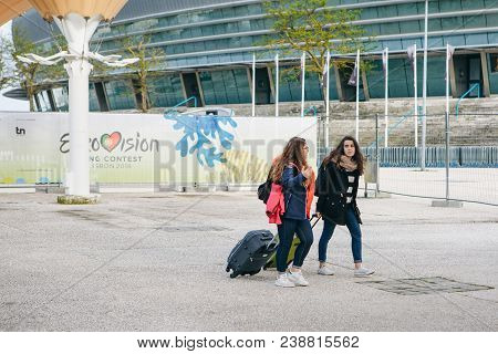 Portugal, Lisbon 29 April 2018: Tourists Or Company Of Friends Or Group Of People Or Pedestrians Or