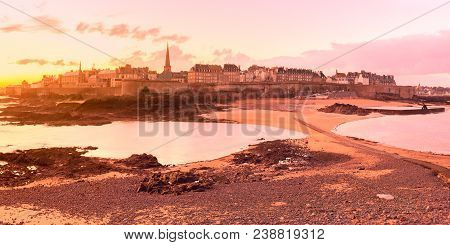 Panoramic view of walled city Saint-Malo with St Vincent Cathedral at sunrise. Saint-Maol is famous port city of Privateers is known as city corsaire, Brittany, France poster