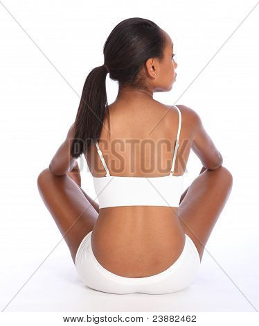 Rear View African American Woman Sits Cross Legged