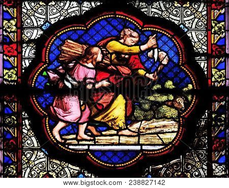 PARIS, FRANCE - JANUARY 05: Isaac carrying the wood of the sacrifice, prefiguration of the carrying of the Cross, stained glass in the Basilica of Saint Clotilde in Paris, France on January 05, 2018.
