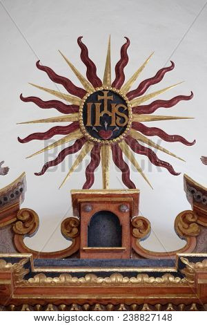 VUKOVOJ, CROATIA - OCTOBER 08: IHS sign on the main altar in the chapel of St. Wolfgang in Vukovoj, Croatia on October 08, 2016.