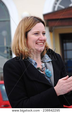 HASTINGS, ENGLAND - MARCH 12, 2011: Amber Rudd, Conservative M.P. for Hastings and Rye, attends a fund raising event for the Victorian pier. She became British Home Secretary in July 2016.