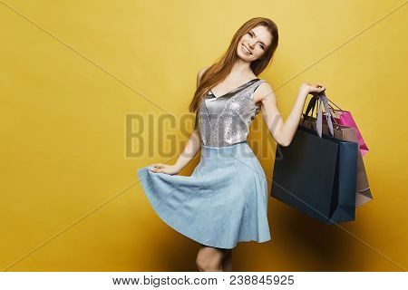 Fashionable And Beautiful Model Girl In Stylish Blue Skirt And Silver Blouse Lifts Her Skirt And Pos