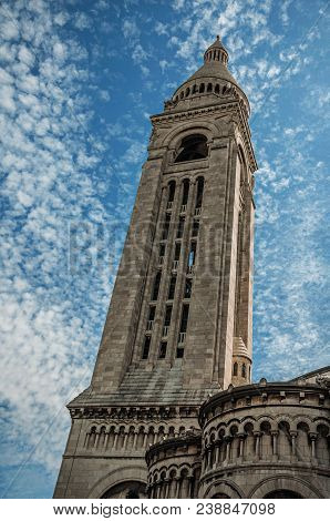 Tall Steeple And Decoration At The Basilica Of Sacre Coeur Facade In Paris. Known As The